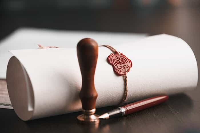A rolled document with a seal